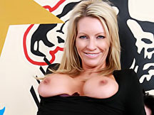 Sexy milf in a tight black top sits on a dick