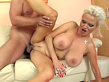 Juggy older chick Sharon sucks and fucks her man until he blasts a load on her.