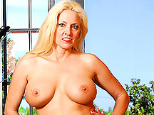 Busty Cougar needs some loving!