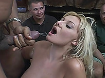 Sexy blond getting a sticky facial while her husband watches