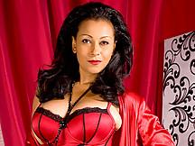 Cougar with dark hair and huge tits masturbates
